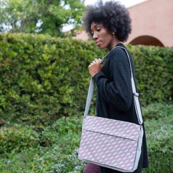 woman with grey messenger bag