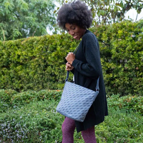 beautiful woman with afro and grey purse