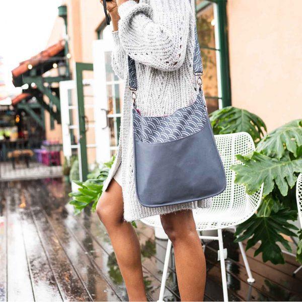 woman with grey cotton handbag