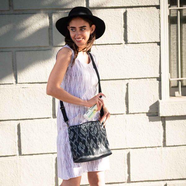 woman with black ikat bag