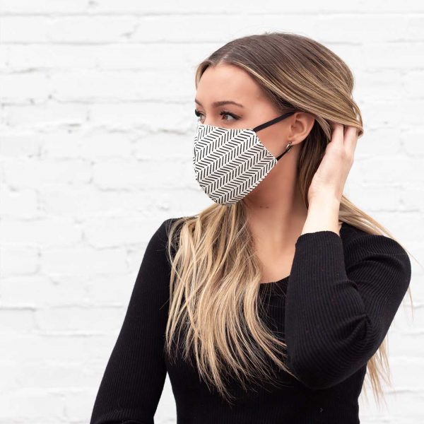 blonde model wearing black and white face mask