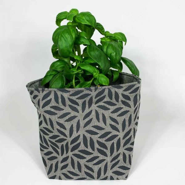 grey planter with basil